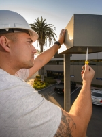 electrical contractor working on light fixture