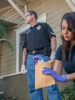 Orange County district attorney and staff re-enactment of crime scene